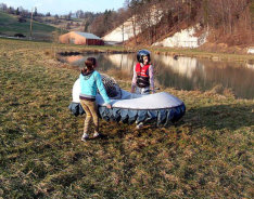 strong girls lifting the kids hovercraft